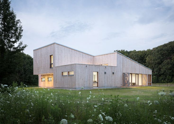 This laboratory in a forest clearing by GO Logic is clad in pale cedar