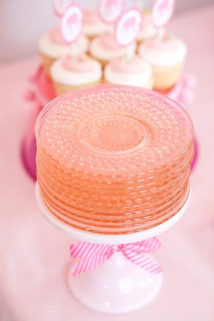 Plates on a cake stand. Such a great idea.