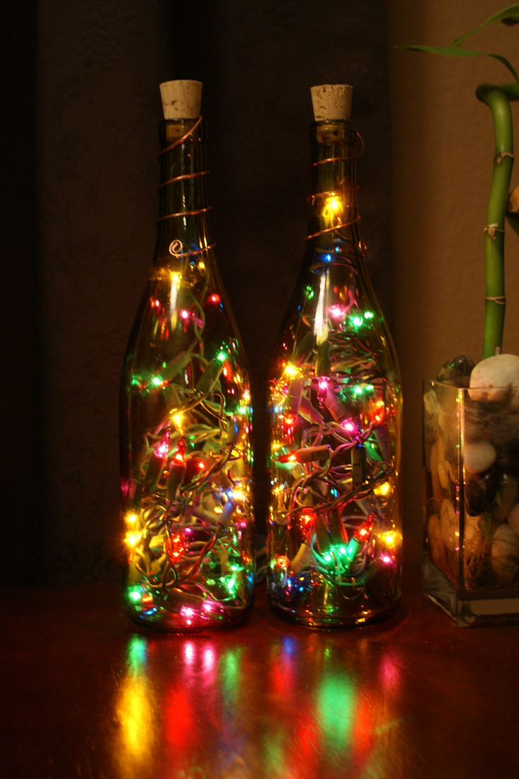 Wine bottles with Christmas lights inside!