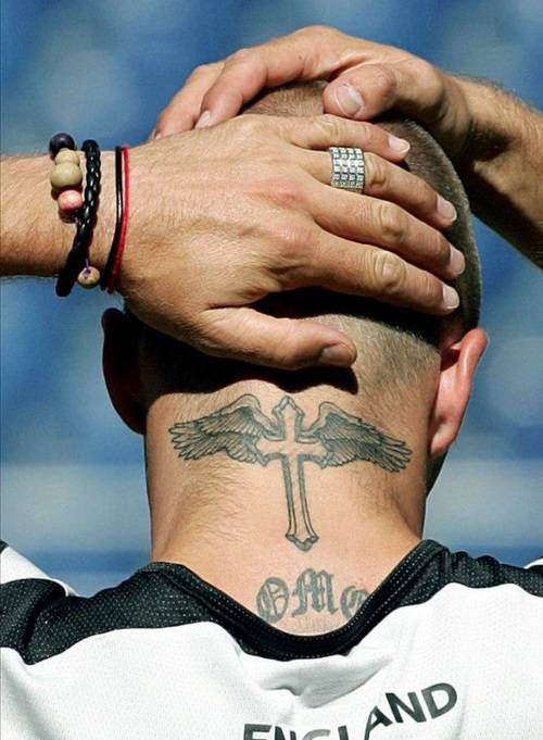 David Beckham Winged cross tattooed in David Beckhams...