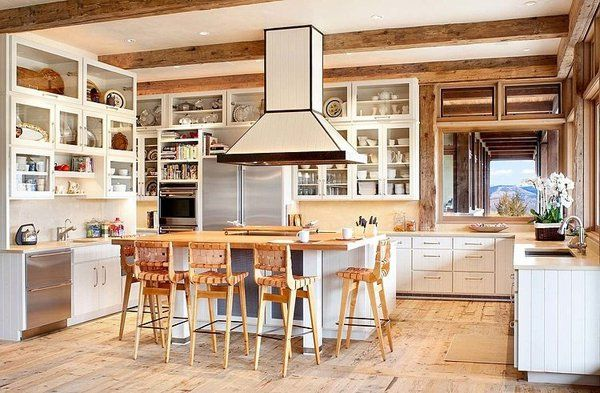 The spacious kitchen is a chef's delight, with an eye-catching range over the island creating a dramatic focal point