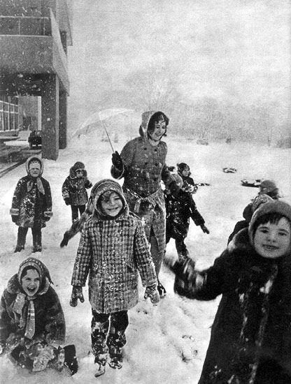 Soviet schoolchildren play in the snow with their teacher (1976).