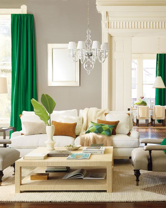 Those green curtains paired with that white couch! So pretty!