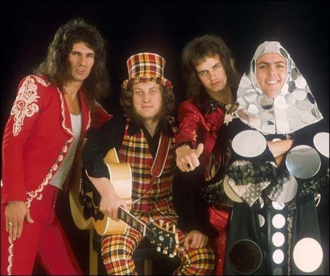 Slade rules! Ignore the disco nun, and focus on the plaid pantsuit with matching tophat.