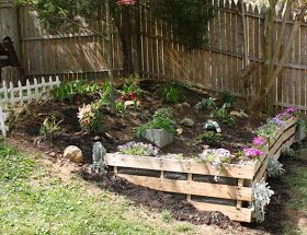 great idea using pallets as a retaining wall flower bed line the inside with landscaping
