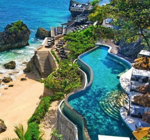 Ayana Resort and Spa Bali, Indonesia. I've had cocktails at the Rock Bar at  sunset, and it was amazing. But I'd love to go back and stay at the resort.