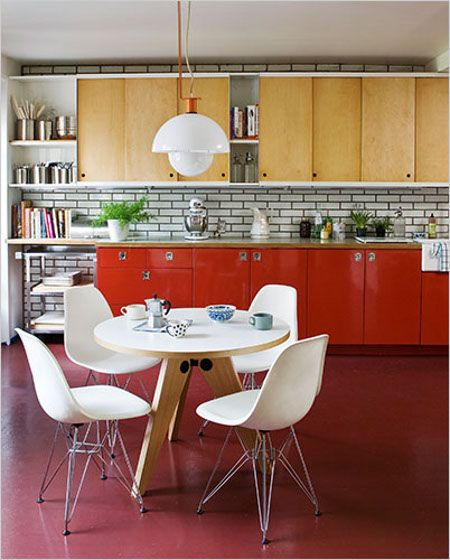 Nice contrast, use of colour and design. Love the white brick and wood/red cabs