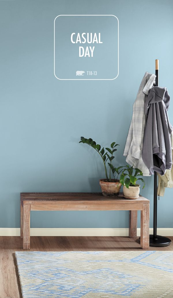 This classic front hallway design features a fresh coat of Casual Day, from the BEHR 2018 Color Trends. When paired with natural wood furniture and a cozy entryway rug, this light blue hue creates a calming environment that you're sure to love. Explore the rest of these modern paint colors to find interior design inspiration for your next DIY home makeover project.