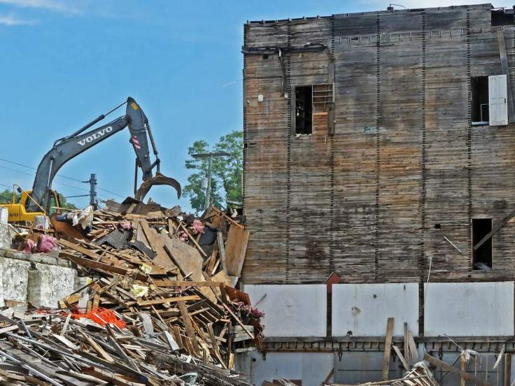 PHOTOS: Grain storage compartments exposed in demolition project | www.arwoodwaste.com