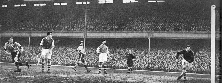 30th January 1954. At Highbury, Arsenal went crashing out of the FA Cup at the hands of Norwich City. Here Canaries centre forward Tommy Johnston scores the equaliser past goalkeeper Jack Kelsey.