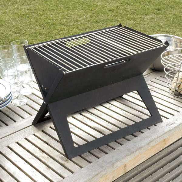 Lodge Sportsman Grill - The Lodge Sportsman Grill is a small-sized portable grill made out of cast iron, and will probably cook some of the best outdoor meals you'll ...