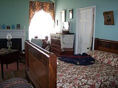 Arlington House, The Robert E. Lee Memorial - The second-floor chamber shared by Lee and his wife. A replica c. 1850 U. S. Army (lieutenant of engineers) uniform lies across the bed.