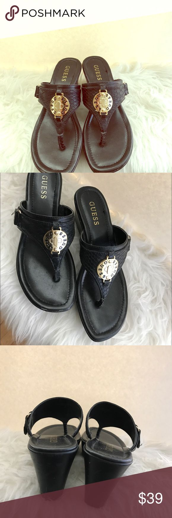 Guess Black Wedge High Heels Sandals Super cute sandals. Wear to bottoms because I wore it once at a pool party. Some scuffing in the front but can't barely noticed (see picture) In excellent pre-worn condition. 2.5 inch heels. Please no trading. Size 7. Guess Shoes Sandals