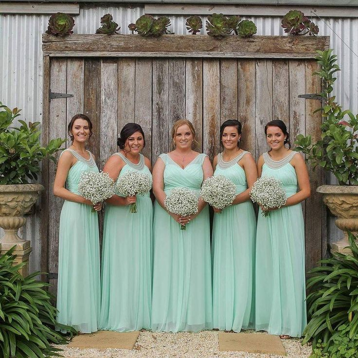 Pretty maids all in a row!  We love how Caitlyn chose to set her maid of honour apart with a slightly different style. #wendyannbridesmaids #mint #rosecottage #blossom3280 #blossomfashion3280 #realwedding @wendy_ann_australia by blossombtq