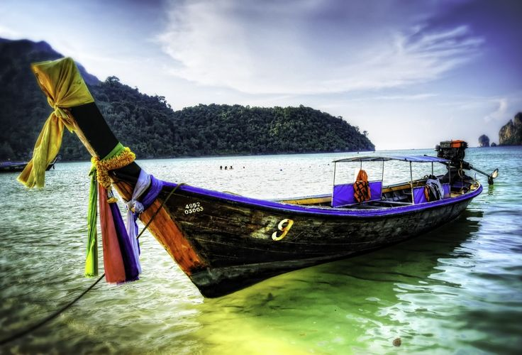 Long Tail Boat, Phi Phi, Thailand puzzle in Puzzle of the Day jigsaw puzzles on TheJigsawPuzzles.com. Play full screen, enjoy Puzzle of the Day and thousands more.