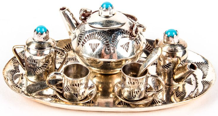 Lot 35 in the 9.1.15 online & live auction! Darling vintage sterling silver miniature tiny tea set with southwestern style pressed patterns. Some pieces are accented with sawtooth set turquoise stones. #Doll #Toy #Southwest