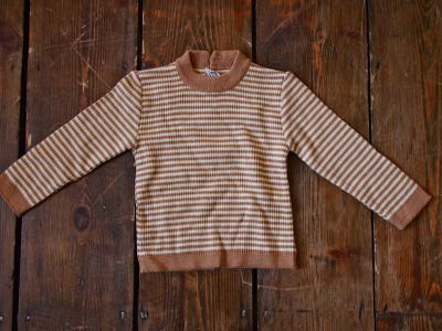 Vintage Striped Italian Jumper 8.00 A practical piece from our collection of vintage clothes for kids.  A gorgeous beige and brown stripped jumper from Italy back in the day!  Great condition.  Size 1 year +  Customise with some of our kids accessories