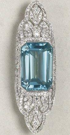 An Art Deco Aquamarine and Diamond Brooch, 1920. Designed as a pierced, openwork pavé-set diamond plaque, centring upon a rectangular-cut aquamarine, mounted in platinum, signed 'Tiffany & Co.'