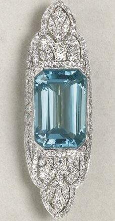 An Art Deco Aquamarine and Diamond Brooch, 1920. Designed as a pierced, openwork pavé-set diamond plaque, centring upon a rectangular-cut aquamarine, mounted in platinum, signed 'Tiffany & Co.'