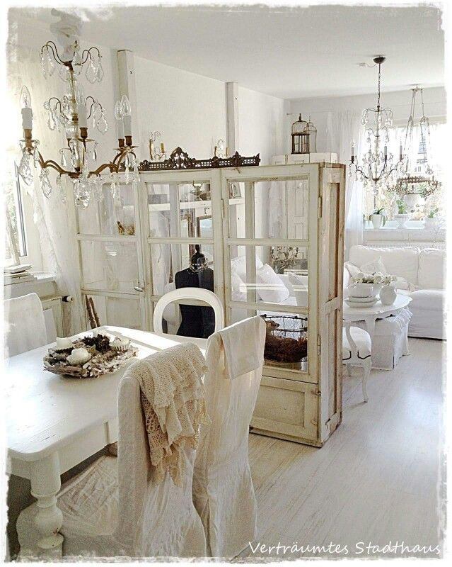 That glass cabinet/room divider looks so great, as if it was made from old windows!