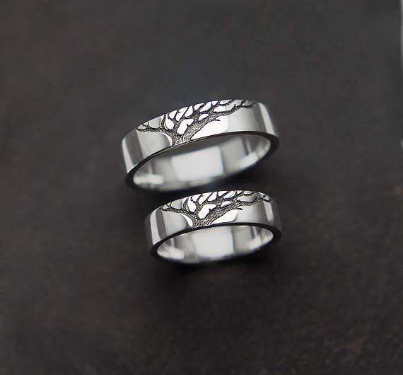 Stylish rings with the eternal family symbol of the tree. A tree is a symbol of growth too. Made of sterling silver. We love simple forms and carefully designed drawing a very much. Inside the tree I made the texture of the bark. Beautiful contrast of white metal and dark drawing, as well