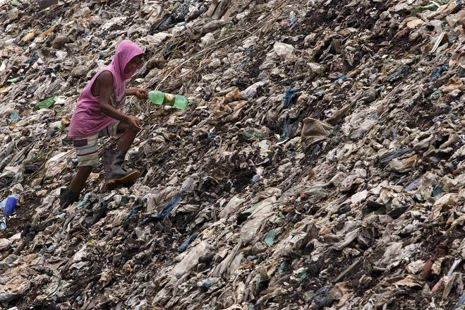 A garbage picker worked at the Aura garbage dump, near the mouth of the Amazon, on the outskirts of Belem, Brazil, March 21.