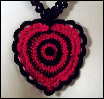 """""""Cupid's Target"""" is an ArtFireEtc's original design, a must have necklace, a fashion statement and a conversation piece for a special Valentine...it is also a one of a kind gift made with love in point lace. #$25.00"""
