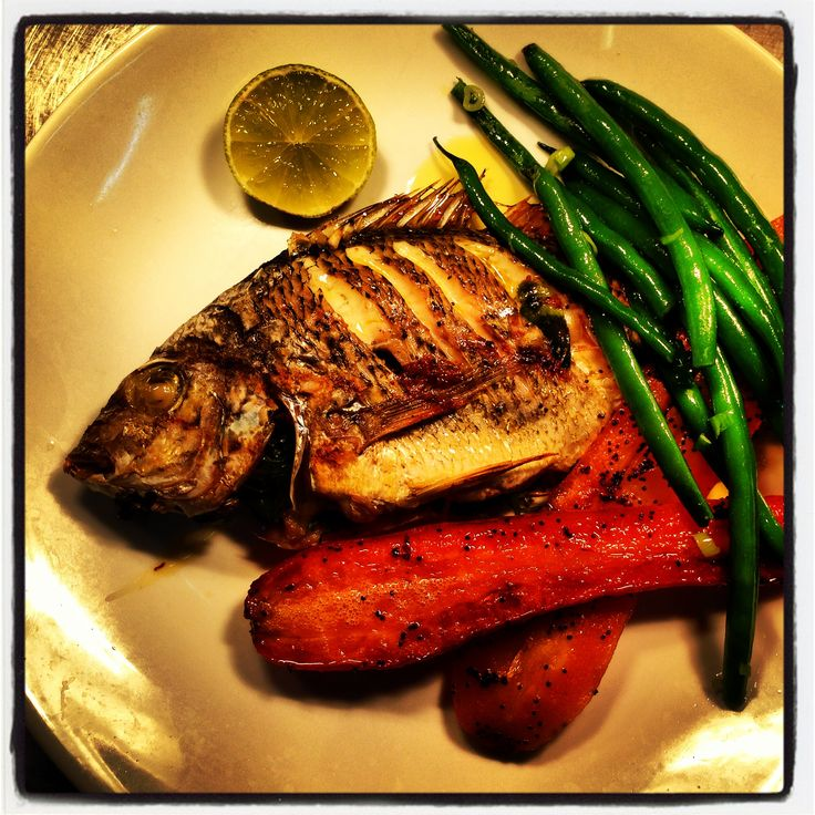 Whole sea bream char-grilled with kaffir lime, chilli & coriander & served with roast poppyseed carrots & green beans