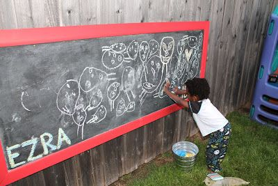 outdoor chalkboard- so awesome. the rain rinses it off (or the hose!) we keep a plastic storage bin- with a lid- by it, for the chalk.