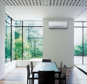 Clean, green living space featuring a Mitsubishi Electric High Wall Heat Pump