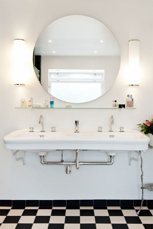 double sink in a Deco inspired bathroom - love the classic black and white floors