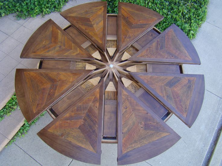 Expandable Round Table by Western Heritage Furniture.