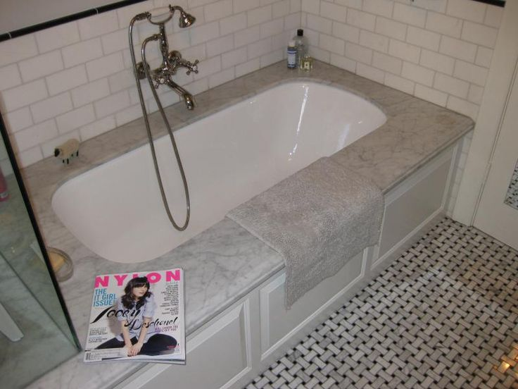 undermount tub with subway tile surround