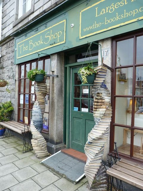 "The Bookshop is located in Wigtown,  Scotland.  The largest secondhand bookshop with over a mile of shelving supporting roughly 65,000 books.""  Gotta love the columns in front!"