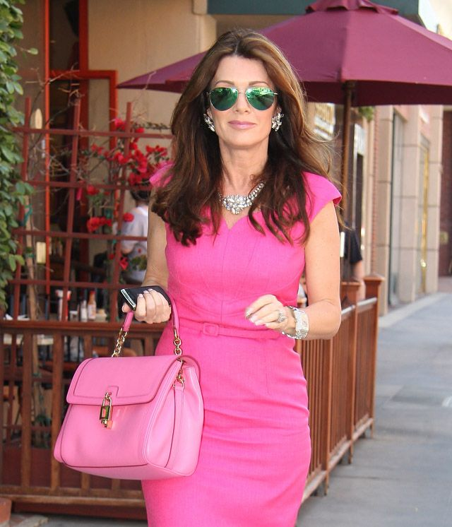 "Check out her very ""Lisa"" hot pink Dolce & Gabbana Miss Dolce Handbags."