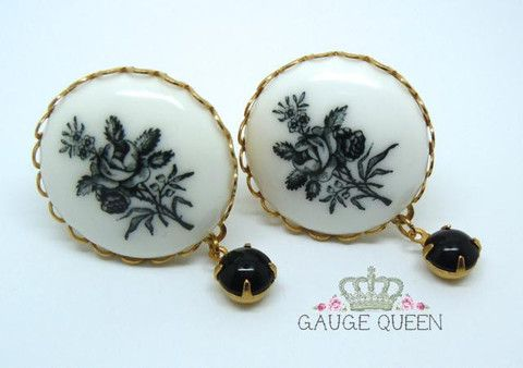"Black Flower & Vintage Drop Plugs - 2g (6.5mm) through 7/8"" (22mm) – Gauge Queen Pretty dangle plugs made with genuine vintage pieces. These are large plugs, from a 25mm (coated) floral porcelain centrepiece hangs a jet black vintage glass bead (7mm). 1/2"" (12mm) pictured."