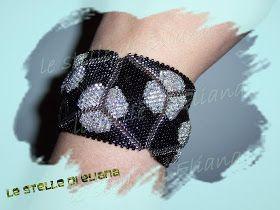 Pubblico anche qui lo schema del mio bracciale Miss Simpatia.....ho fatto questo bracciale dopo averne visto uno simile al braccio di una s...