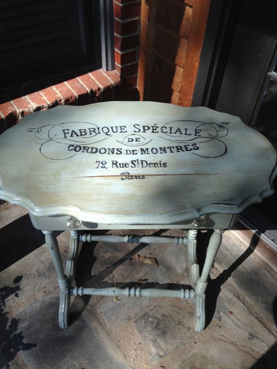Antique occasional table painted French blue with handpainted French typography. Sorry no shipping
