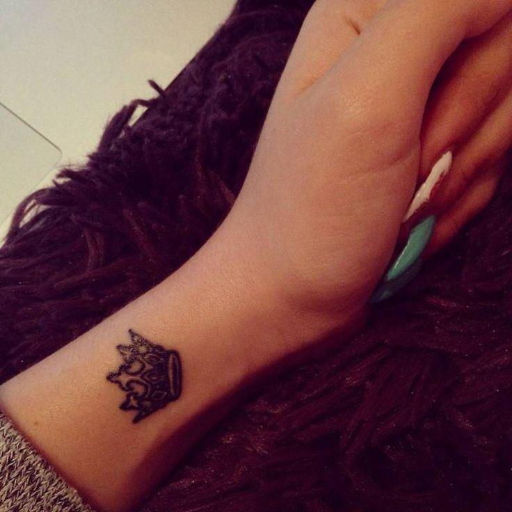 Wrist tattoo of a crown on Gabriella.