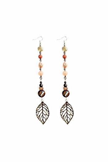 """These earrings were handmade in our boutique. The earrings feature locally sourced beads as well as hematite sourced from open-air markets in Kenya. The earrings are lightweight and fun. Make them yours today.  Length: 7"""" long, Width: 1"""" (at the widest point) #Ottawa #Alaska #Juneau #Osaka #Japan #Jewelry #Hawaii #Washington #NewYork #Brooklyn #Tallahassee #Tampa"""