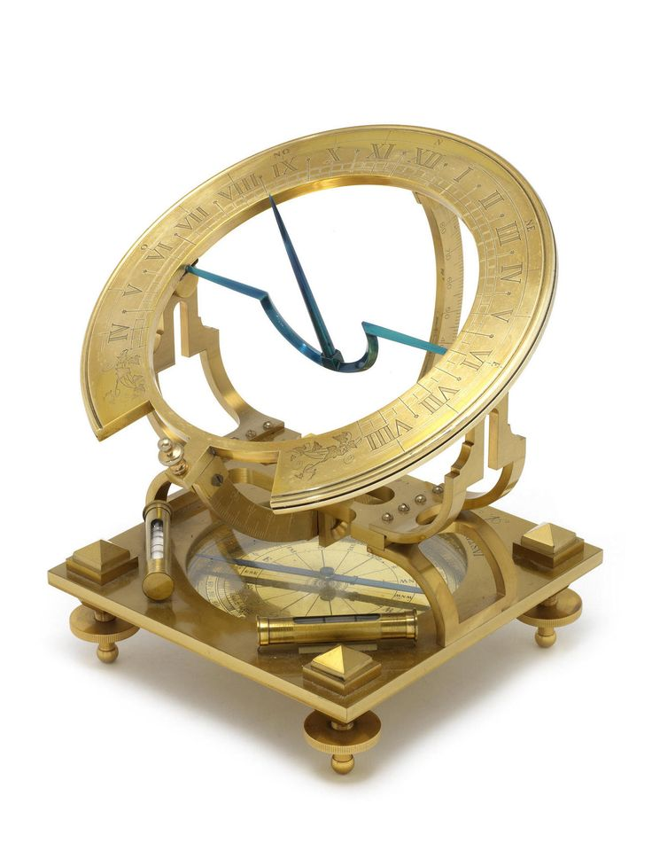Library decor : A large gilt brass A. Moretti Inclining dial, signed A. Moretti Roma INSTRUMENTS DES SCIENCES, with blued metal gnomon, hour ring engraved with Roman numerals moving over a 180 degree arc, supported by a bracket above inset brass compass rose with blued steel needle under glass cover, raised on four levelling screws - Dim: the base 7 1/2 ins (19cm) square.