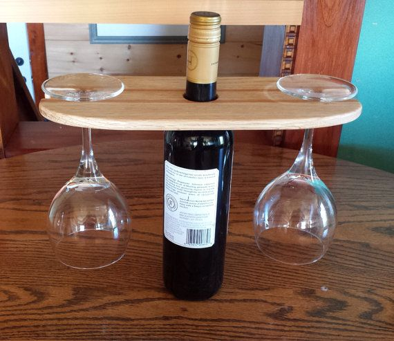 This beautiful slender wine bottle & glass holder has room to hold two wine glasses which slide into slots at each end where they hang until