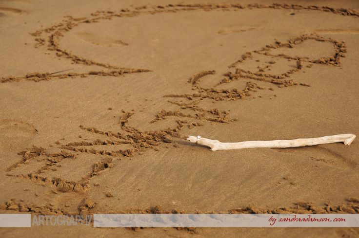 Just Engaged Written in the Sand...if you are looking for an engagement photographer visit my online portfolio at www.sandraadamson.com  All images are available for sale please inquire through the website above for pricing.