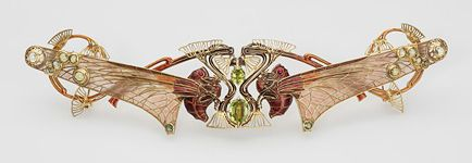 Corsage ornament, which could also be worn as a hair slide. 1903-1905. Engraved Lalique. Paris. Gold with en ronde bosse, plique a jour and champleve enamel, cabochon rubies, faceted and cabochon peridots. From the Khalili Collections at the Hermitage Museum.
