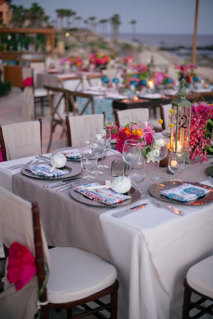 Love the shabby-chic feel with mix of flowers and colorful mis-matched napkins. http://www.stylemepretty.com/destination-weddings/2014/05/23/colorful-cabo-wedding/
