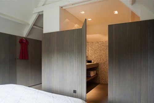 House GL is a renovation of a 1970's country house in the suburbs of Brussels, Belgium designed by the collaborative design firm, Architectslab. The shell