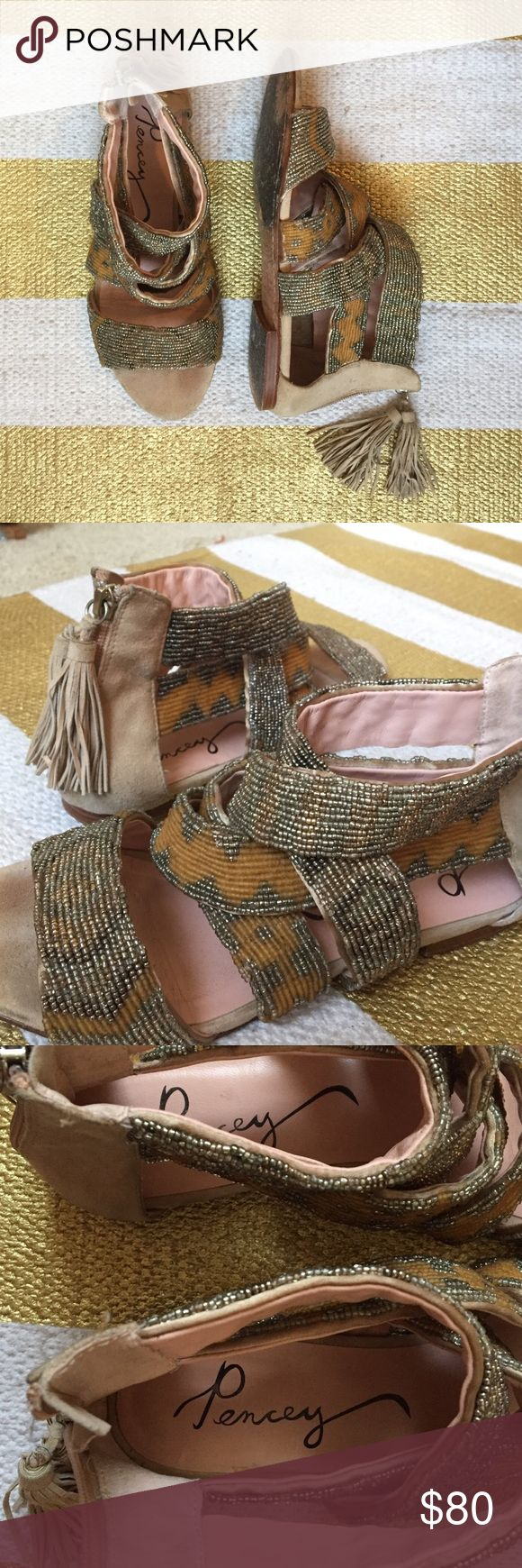 Dante Sandal by Pencey Criss-cross strap sandals with beautiful beaded geometric patterns. Tasseled zipper closers in the back. Cream suede. Very comfortable! Leather interior. Great neutral sandal with just enough pizazz. Anthropologie Shoes Sandals