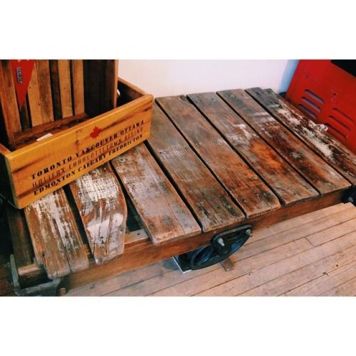 Vintage Train Push Cart we sanded these down and stained them so they can work as a industrial style coffee table!