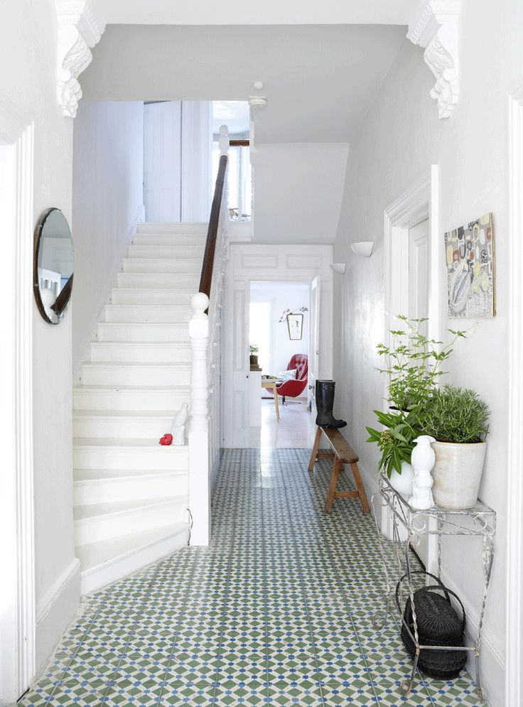 This all white hallway has tones of character with these Moroccan floor tiles, a simple wooden bench and an aged vintage console table. Everything just seems to work seamlessly together. I love the look.