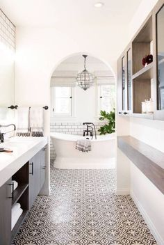 beautiful modern eclectic bathroom arched doorway bathtub tile